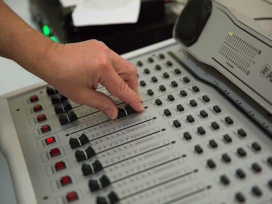 Bruce Ernst demonstrates the new sound board for KTAL