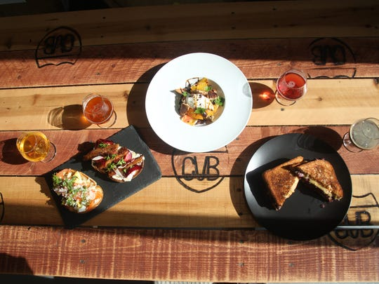 The KUMA Catering pop-up restaurant at The Coachella Valley Brewing Company offers a variety of dishes including from left to right the The Citrus Cured Salmon Toast and Pork Belly Toast sandwiches, the Caprese Salad and the hearty Reuben.