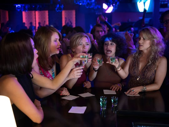 "Zoë Kravitz, left, Jillian Bell, Scarlett Johansson, Ilana Glazer and Kate McKinnon buckle in for a prewedding blowout in ""Rough Night."""