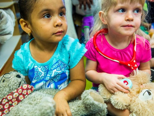 Preschoolers Nicole Gutierrez, left, and Gianna Bramhill, both 3, examine their stuffed bears during Teddy Bear Clinics put on by MedExpress Urgent Care staff at Child's Path preschool in East Naples on Thursday, June 29, 2017. During this free outreach program, kids learn about going to the doctor through examining their stuffed animals with toy medical tools.