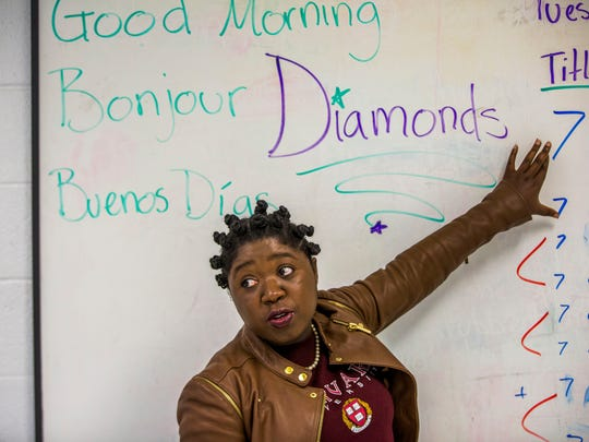 Diana Saintil teaches a math course at the Boys and Girls Club of Collier County on Tuesday, June 27, 2017. Saintil will be attending Harvard in the fall for her masters in education policy and management.