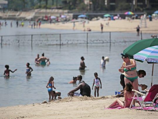 Crowds enjoy the beach at Rye Playland Beach on July