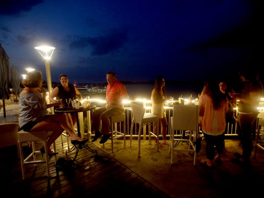 Jim Loy of Haverstraw and his daughters Ferith, of Peekskill, and Valere, of Garnerville, enjoy a Friday evening out together on the deck of the Hudson Water Club in West Haverstrawm June 30, 2017.