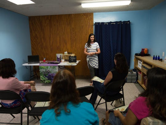 Morgan Hiles, doTERRA wellness advocate, explains the uses of essential oils on dogs and cats, during a class she gave at Your Pet Space on Thursday, June 29, 2017.