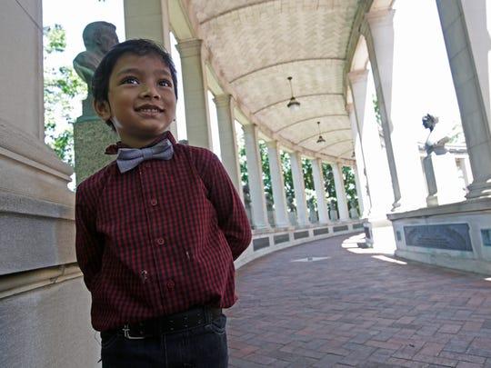 Suborn Issac Bari, 5, walks along the Hall of Fame