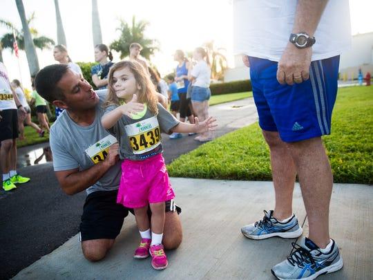 Mike Friedmann helps his daughter, Bella, 3, tuck in
