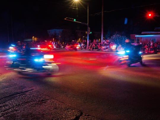 Las Cruces Police Department motorcycle units cruising in the intersection of Solano and Madrid at the start of the 2017 Electric Light Parade. Monday, July 3, 2017.