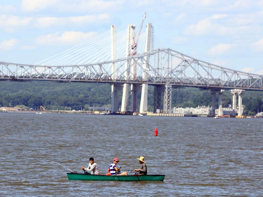 With the Tappan Zee Bridge as a backdrop, men fish near the Piermont Pier July 4, 2017. People flocked to the river throughout the day to enjoy the perfect holiday weather.