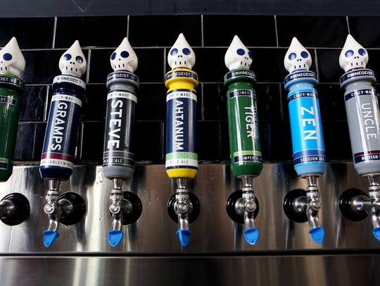 Tap handles of various beers by Rhinegeist Brewery