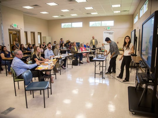 """Juan Santos, 15, and Galilea Pedraza, 17, present their app, """"Immokalee Transit,"""" to the judges as part of The Immokalee Foundation's ENGAGE Summer Academy on July 6, 2017. The six week program taught students to write, code, and ultimately create an app to help satisfy a community need. Scholarships for post-secondary education were given to first, second, and third place as well as a $100 scholarship to all who participated."""