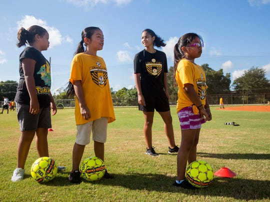 Maria Rodriguez helps coach practice of fifth- and sixth-grade girls from Immokalee Community School at Immokalee Community Park on July 6, 2017. Rodriguez is not eligible for federal financial aid because she is a Deferred Action for Childhood Arrivals (DACA) recipient, so the community raised money to help her pay for school. She will be attending Broward College and will play soccer.