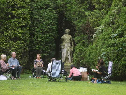 A group of concert goers found a quite spot for a picnic