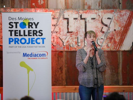 Tina Hill tells a story at the Des Moines Story Tellers