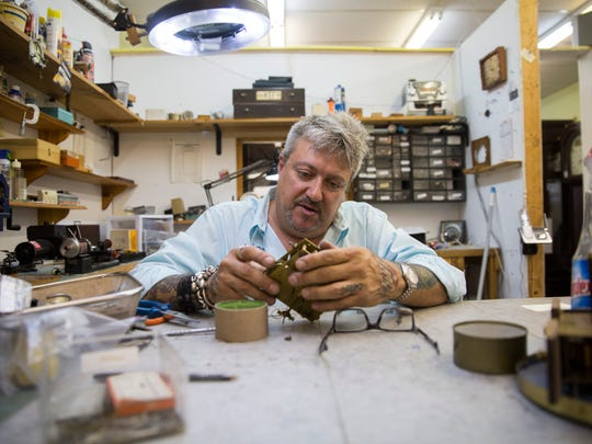 Benny Daidone, owner and master craftsman of Clockmaster of Naples, works on repairing the inner workings of a clock in his shop on Thursday, July 13, 2017. Daidone has been in the clock repair industry for 32 years and recently took over the East Naples shop.