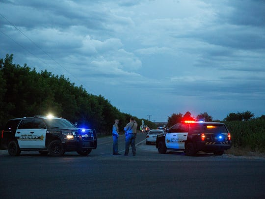 Doña Ana County Sheriff's deputies stand guard on Highway 28, near where a dramatic car chase through Las Cruces streets and surrounding interstates came to an end Thursday, July 13, 2017.