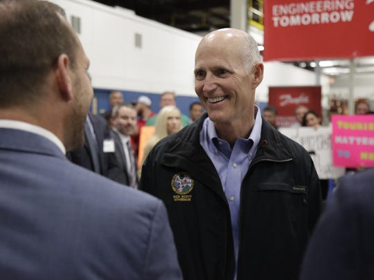 Governor Rick Scott met in March with business leaders at Danfoss Turbcor to discuss jobs, tourism, and the impacts of Visit Florida and Enterprise Florida. Here he meets local entrepreneur and co-owner of The Edison restaurant Adam Corey who participated in the roundtable.