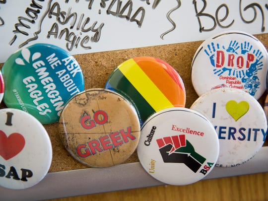 """""""Safe Zone"""" stickers and buttons lay scattered throughout the Office of Student Involvement inside the Cohen Center on Florida Gulf Coast University's campus Friday, July 14, 2017 in Fort Myers."""