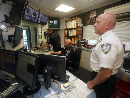 Port Chester Police Chief Richard Conway watches as