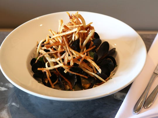 Moules marinieres with white wine cream sauce, shallots