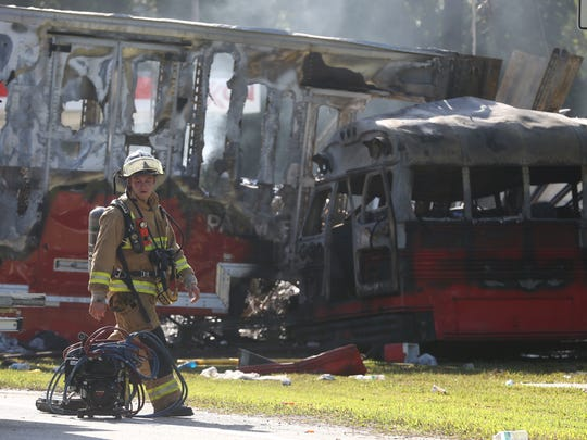 First responders work the scene of a highway crash in July 2016 that killed four people and injured 32.