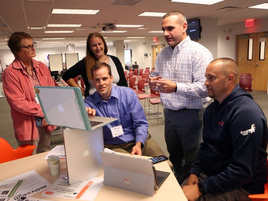Carmel Middle School library media specialist Liz Krieger, left, and educators from Mahopac; Jen Cauthers, Adam Pease, Greg Stowell and Brian Cauthers work together in an active learning center during a workshop by the LHRIC; the tech arm of BOCES, July 25, in Harrison.