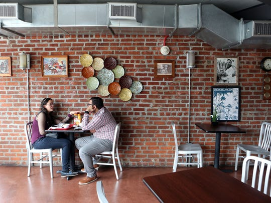 A couple eats lunch at El Castillo Restaurant and Grill