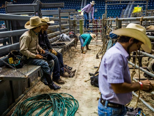 Bull riders prepare to compete in the Professional Bull Riders Touring Pro Division at Germain Arena on Friday, July 28, 2017.