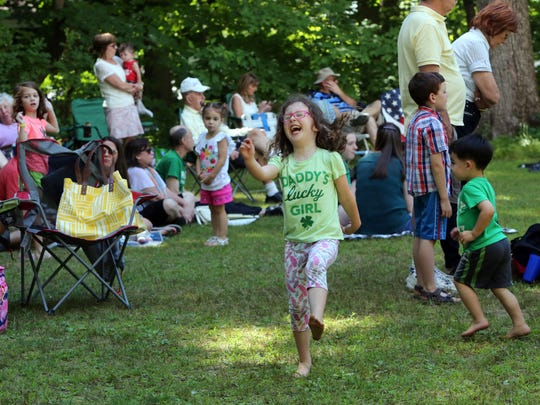 Maggie Stoneburner, 4, dances during the Irish heritage