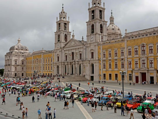 Parked cars in Mafra after the parade of Citroen classic cars 2CV during the World 2017 2CV Meeting July 30, 2017.