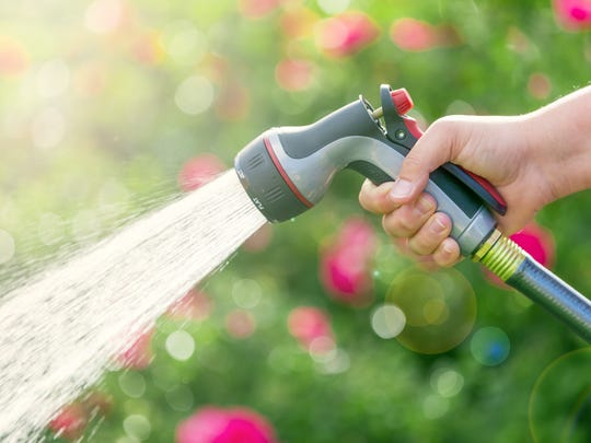 Getty Images/iStockphoto Photograph of a hose in hand