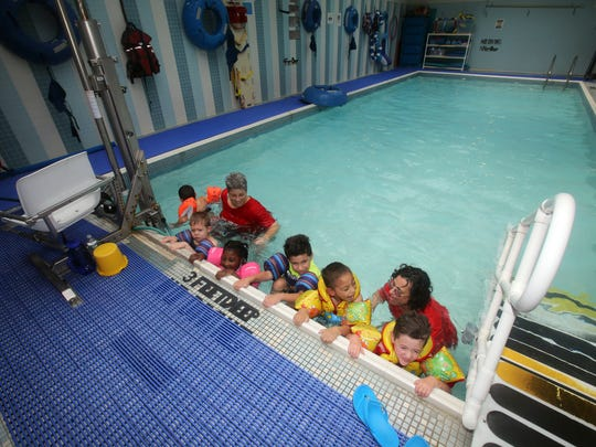 Susan Melcer, swim instructor at the Rockland BOCES Kaplan School, and teacher assistant Tammy Jones swim with children in the pool at the Kaplan School in West Nyack Aug. 2, 2017. Rockland county residents will vote in a referendum on Aug. 9th to approve construction of a new adaptive pool complex to replace the existing pool, which is 40 years old.