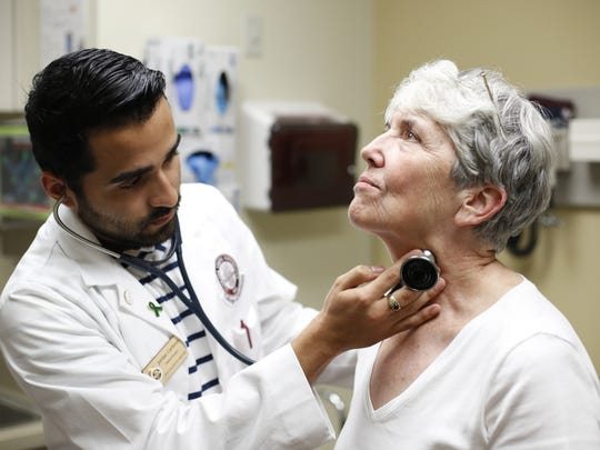 Second-Year medical student Jordan Carbono, left, demonstrates an interaction with Standardized Patient Bobbi Hill in the Clinical Learning Center of Florida State's College of Medicine on July 19.