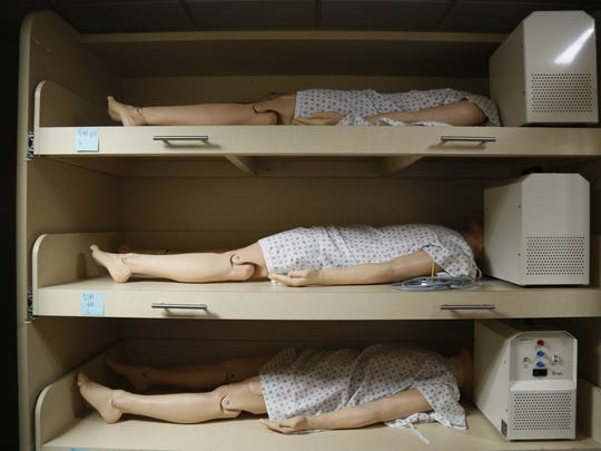 "Sophisticated patient simulators in the ""mannequin morgue"" at the Clinical Learning Center in Florida State's College of Medicine July 19."