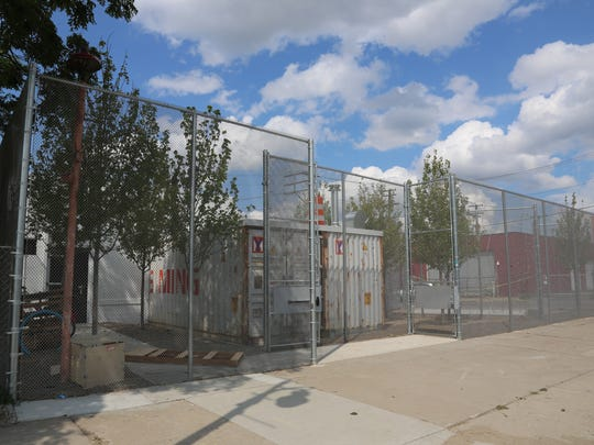 A 16-foot-high chain-link fence now surrounds Katoi restaurant in Corktown, which was torched by a suspected arsonist in February 2017. The fence acts to separate the space and outdoor patio from the busy Michigan Avenue thoroughfare and acts as a security measure.