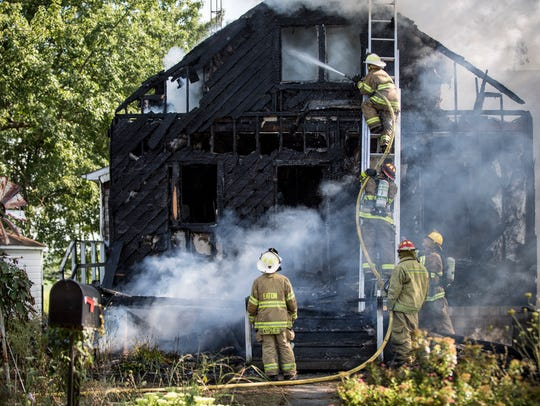 Firefighters from several departments try to tackle