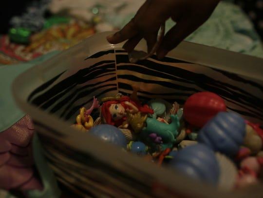 Cora Baisden, 6, shows off some of her favorite toys