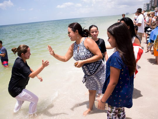 Friends, family, and members of First Baptist Church of Naples gathered for a special beach baptism ceremony Sunday, August 6, 2017 in Naples. Over 30 individuals were baptized by 11 pastors at the church during the ceremony.