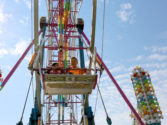 Kids enjoy a ride on the Ferris wheel at the Manitowoc County Fair in 2016.