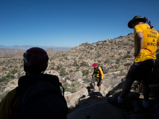 Joshua Tree National Park Search and Rescue Team (JOSAR), member search for clues of Joseph Orbeso and Rachel Nguyen. Both went hiking near the Maze Loop at the park but have not been seen since July 27, 2017.