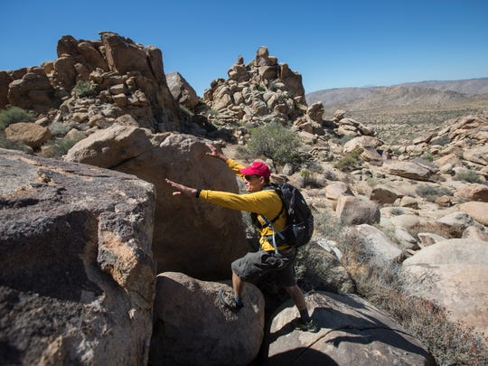 Byron Cook, a member of the Joshua Tree National Park Search and Rescue Team (JOSAR), leads a group of friends and family of Joseph Orbeso. Orbeso and his friend Rachel Nguyen went hiking near the Maze Loop at the park but have not been seen since July 27, 2017.