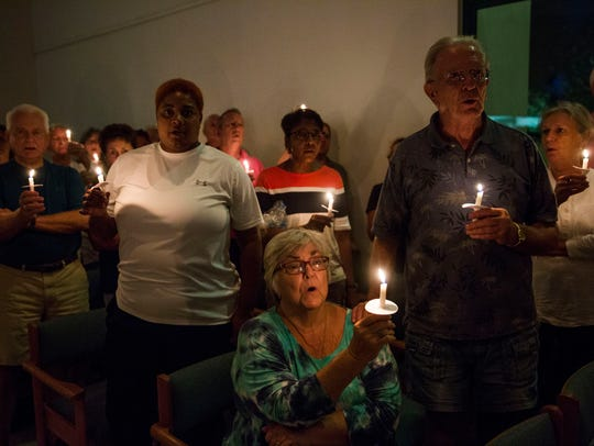 A candlelight vigil during Showing Up Against Hate: