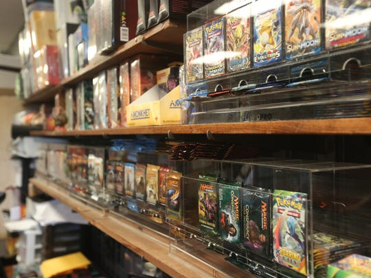 """Shelves at Dungen Games are filled with tabletop games such as """"Magic: The Gathering."""""""