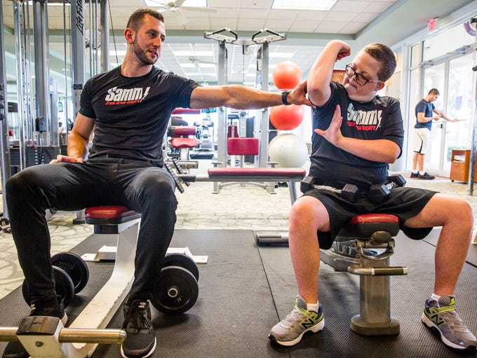 Parker Seward, 13, flexes his muscles for personal