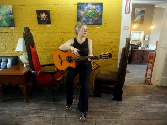 "Folk singer/songwriter and Cold Spring resident Dar Williams, has written a new book titled, ""What I Found in a Thousand Towns: A Traveling Musician's Guide to Rebuilding America's Communities - One Coffee Shop, Dog Run, & Open-Mike Night at a Time."" The book looks at  what brings communities together. Williams, photographed Aug. 16, 2017 at Bank Sq. Coffeehouse in Beacon, believes that coffee shops are one of the places where members of a community come together and bond."