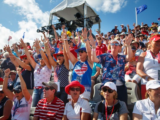 Golf fansÊcheer for the United States team during the