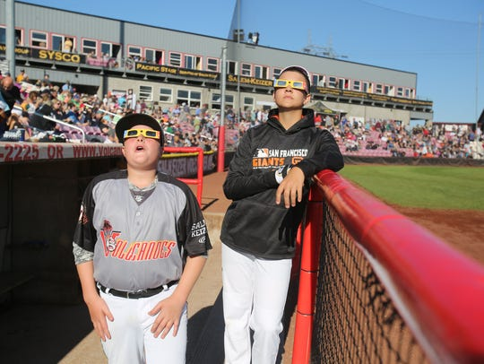 Bat boys Brady Johnston, 14, Left, Danny okada, 15