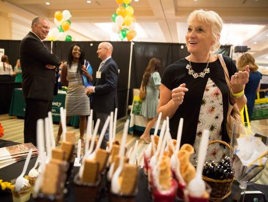 Cindy Jones tries a dessert treat prepared by Seasons