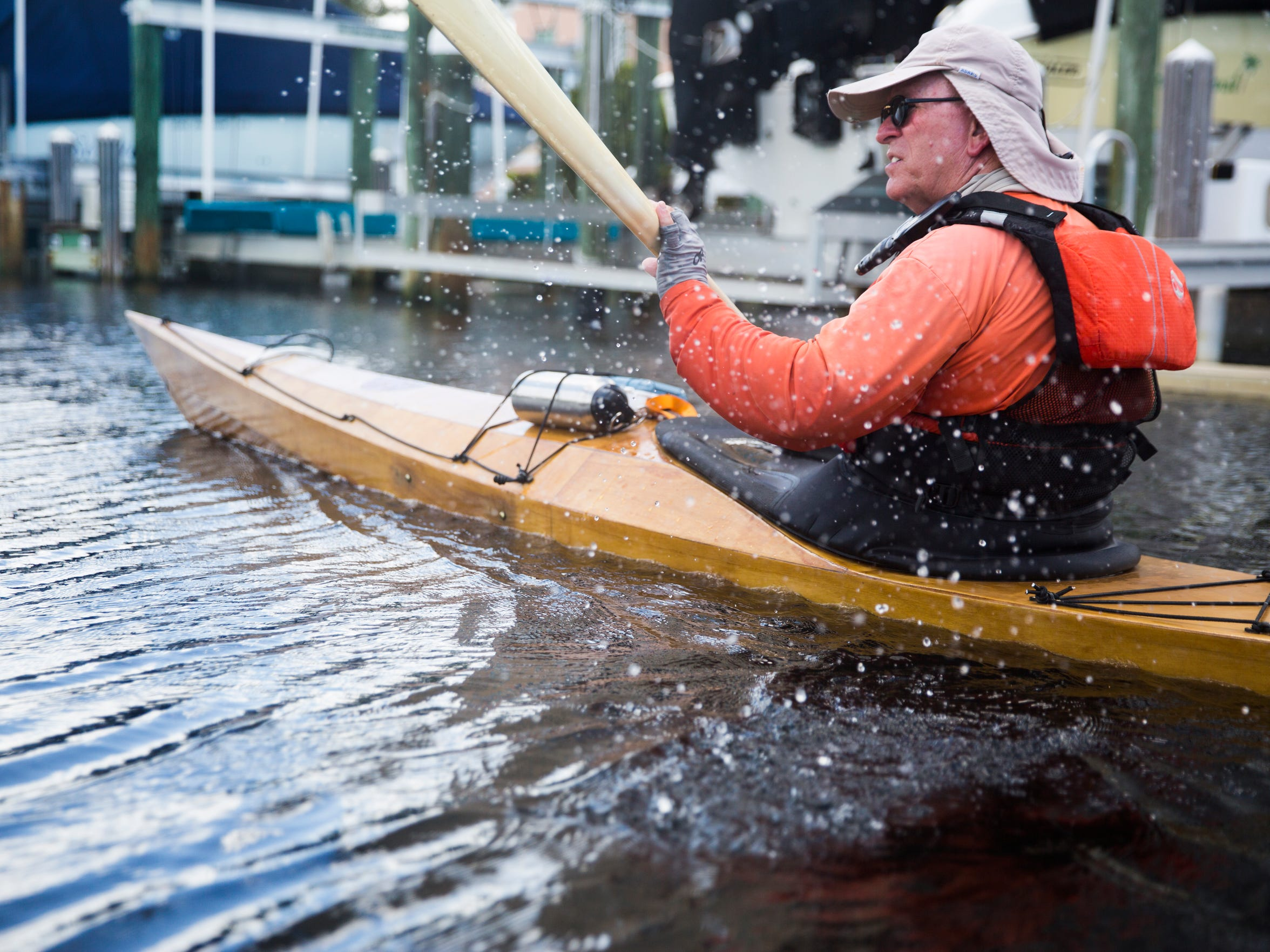 Mike Devlin paddles back into Wiggins Pass on Wednesday, Aug. 9, 2017, in North Naples. Devlin runs a kayak tour business and gives lessons.