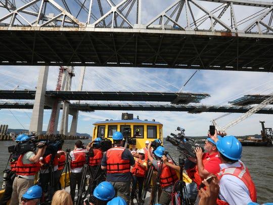 Photographers point their cameras up toward the Tappan Zee Bridge and the new Gov. Mario Cuomo Bridge Aug. 23, 2017.