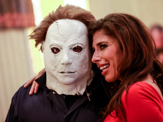 Steve Bairdone, dressed as a character from Halloween, gets a photo with actress Felissa Rose from Sleepaway Camp, at Days of the Dead Indy, Friday, June 26th, 2015.